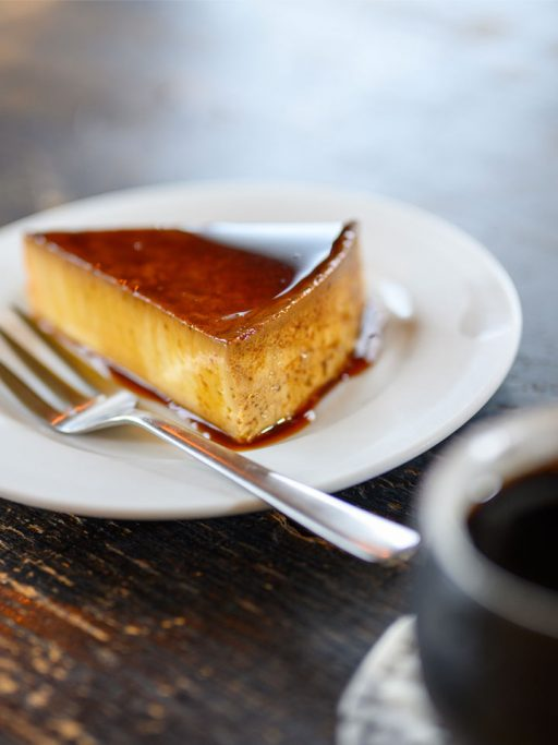 Cheese cake with caramel on a white plate